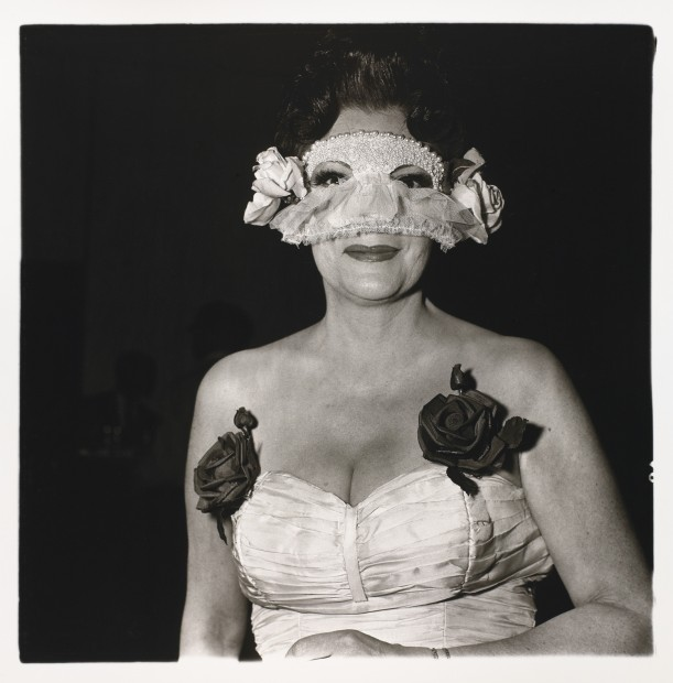 Lady at a masked ball with two roses on her dress, N.Y.C.