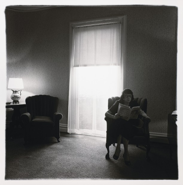 Lady in rooming house parlor, Albion, N.Y.