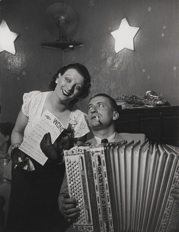 Kiki with her accordian player at the Cabaret des Fleurs, Rue de Montparnasse