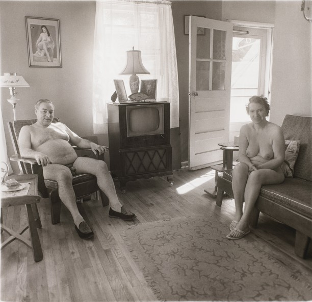 Reitred man and his wife at home in nudist camp one morning, N.J.