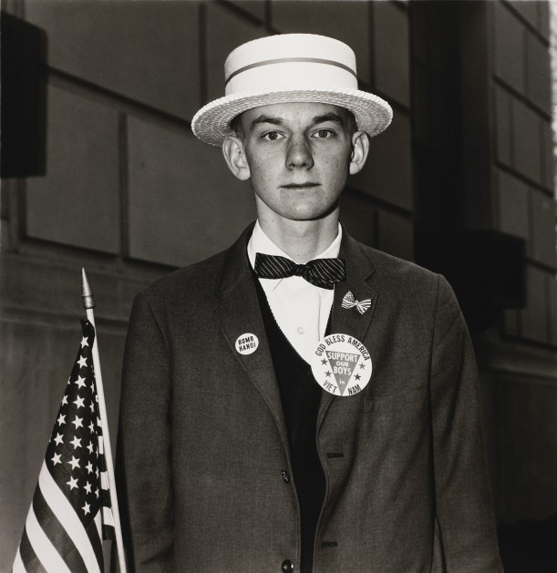Boy with a straw hat waiting to march in a pro-war parade, N.Y.C.