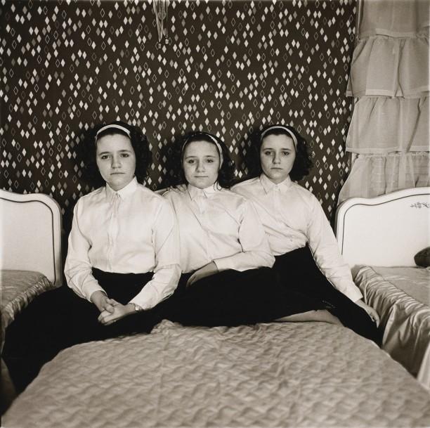 Triplets in their bedroom, N.J.