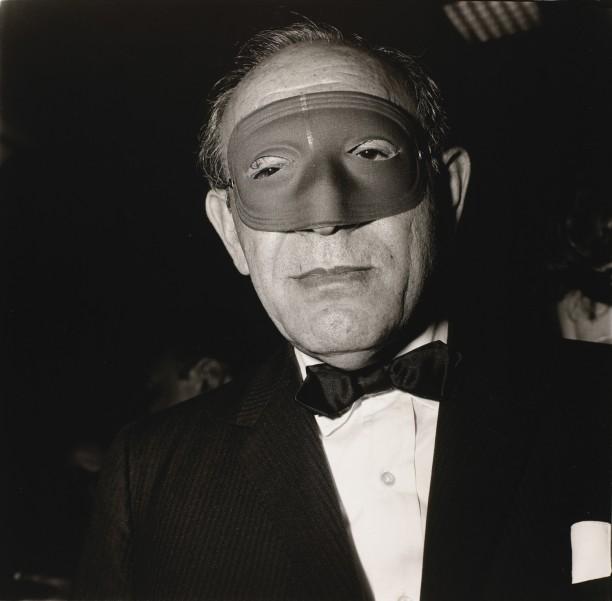 Masked man at a ball, N.Y.C.