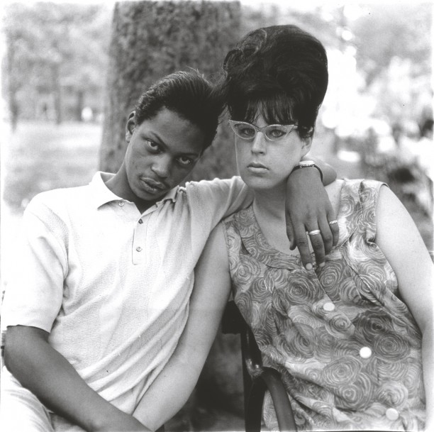 A young man with his pregnant wife in Washington Square Park, N.Y.C.