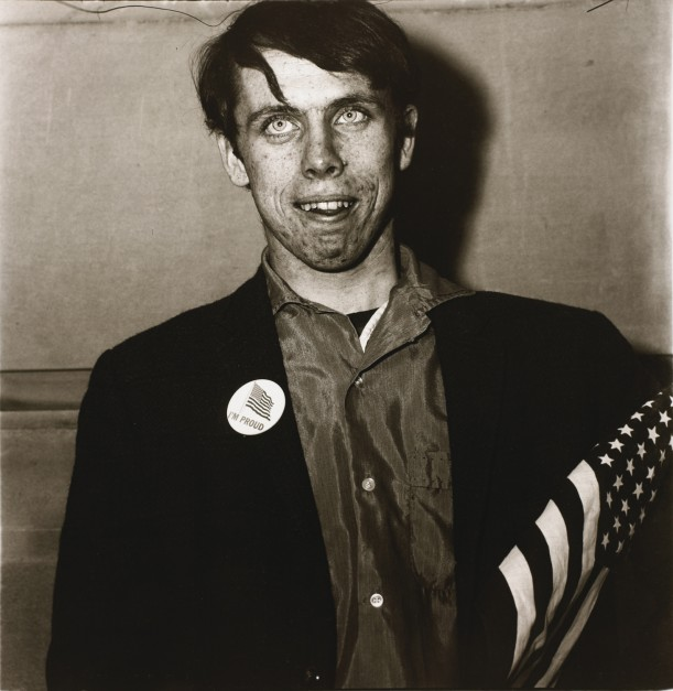 Patriotic young man with a flag, N.Y.C.