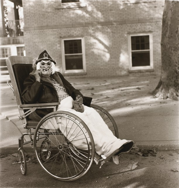 Masked woman in a wheelchair, Pa.