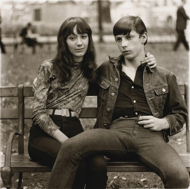 A young couple on a bench in Washington Square Park, N.Y.C.