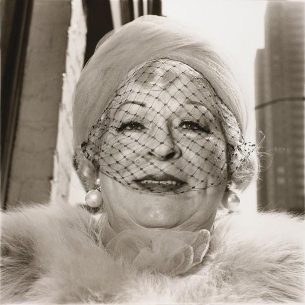 Woman with a veil on Fifth Avenue, N.Y.C.