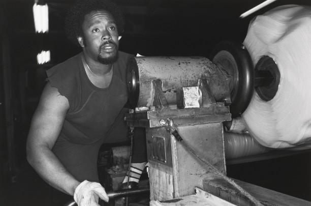 AKRON, OHIO (man leaning over machine)
