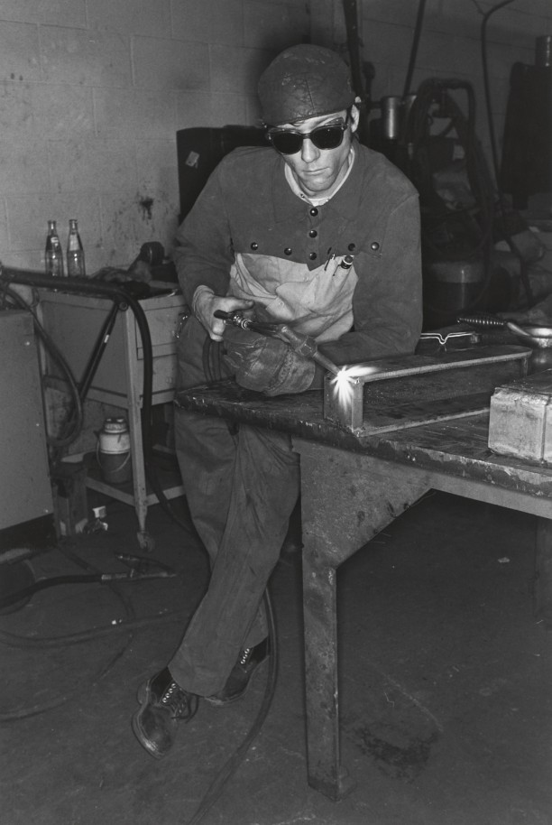 AKRON, OHIO (man leaning and welding)