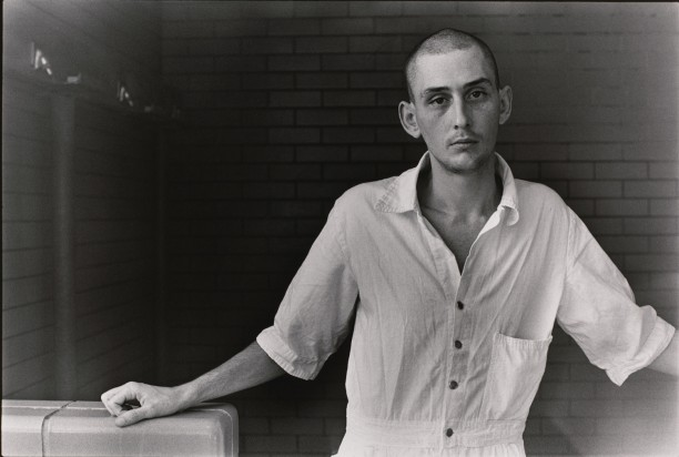 Untitled (Inmate with shaved head in white uniform)