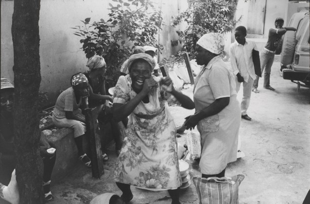 Women that sell food outside the Copa Club reenact the attacks upon the Tontons Macoute