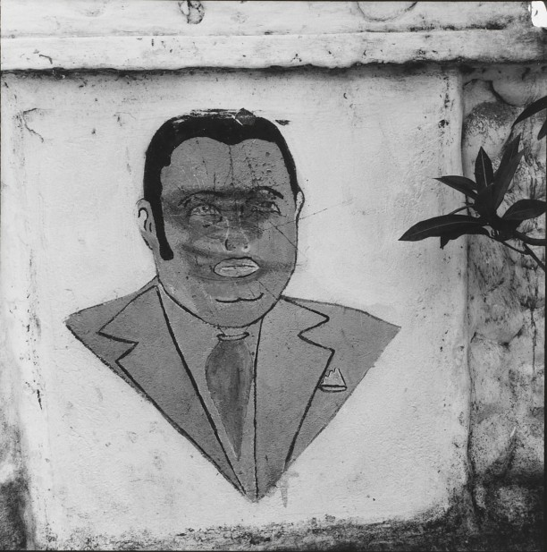 Baby Doc. Defaced mural in Léogâne