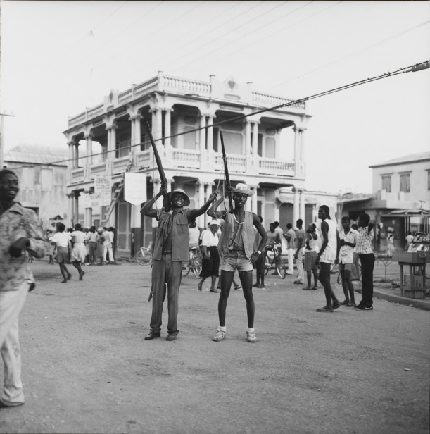 Two youths imitate the Tontons Macoute during Mardi Gras, Gonaïves