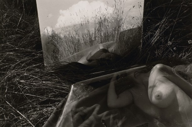 Untitled: Woman Looking At Her Reflection Under Plastic