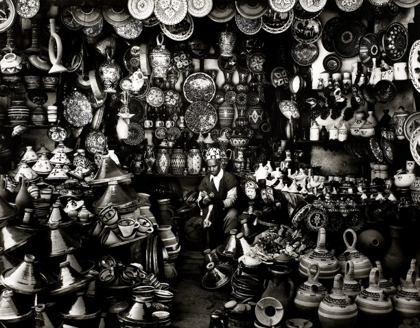 Shopkeeper with Clay Pots in Marrakech