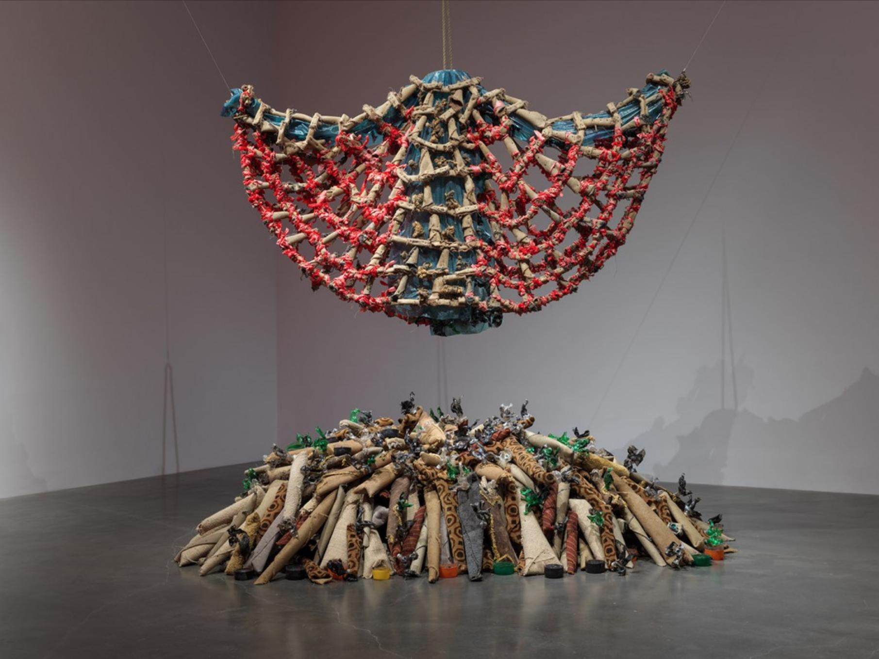 Nari Ward, Carpet Angel, 1992, Carpet, plastic bags, plastic bottles, vinyl carpet runner, springs, wood screws, and rope.